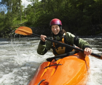 hybrid hearing man on kayak