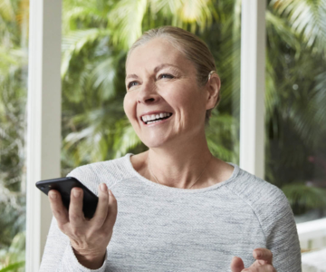 woman with bimodal solution using phone
